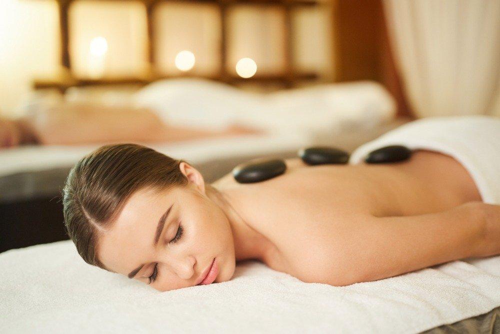 Woman-enjoying-hot-stone-massage